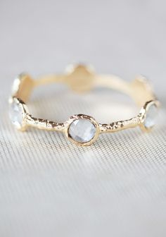 """Loving Promises Bangle In Gold By Marlyn Schiff 23.99 at shopruche.com. Designed by Marlyn Schiff, this beautifully textured gold colored bangle is perfected with faceted crystal clear accents.3"""" diameter"""