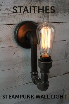 A bespoke handmade Steampunk Wall Light, beautifully blackened to a gun metal colour and hand finished with a bees wax coating to give a gorgeous sheen.     Available now in our etsy shop.