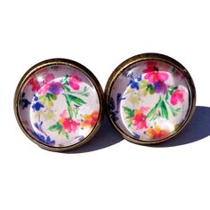 Bright Floral Print Earrings Handmade earrings with bright floral print images under glass domes. Bundle 3 pairs for $12, comment with your choices or create a bundle to get discount. ❤️. Customer photos shown for size comparison only. Handmade Jewelry Earrings