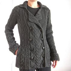 This cabled coat from Shirley Paden's Knitwear Design Workshop is an example of a double-taper body with a double-breasted front overlap. It features straight shoulders, v-neck shaping, and tapered sleeves with shaped turn-back cuffs and set-in caps. The cuffs, collar, and lapels are worked separately and sewn in place.