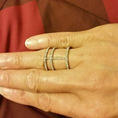 Double H ring in Silver Triple bonded design with crossbar  Pave studded  Rhodium plate over Base Metal , Crystal  This silver ring looks gorgeous styled with diamonds  NWOT  Never worn except to model  Ring size 6 Ella Jewelry Rings