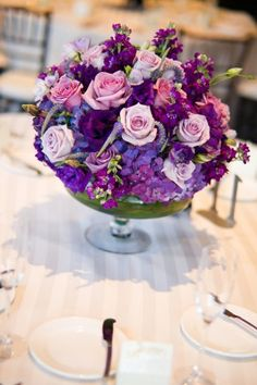 Are you thinking about having your wedding by the beach? Are you wondering the best beach wedding flowers to celebrate your union? Here are some of the best ideas for beach wedding flowers you should consider. Purple Wedding Centerpieces, Wedding Table Centerpieces, Wedding Bouquets, Wedding Decorations, Purple Centerpiece, Purple Wedding Flowers, Purple Roses, Pretty Flowers, Orange Wedding