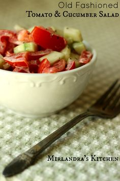 Tomato and Cucumber salad is a simple chopped salad seasoned with salt and pepper and dressed with a touch of light mayo. It's a healthy salad that tastes decadent. Make it from your garden or after a trip to the farmer's market and enjoy with dinner or some good BBQ.  This is a great recipe to play with and make your own with dill, garlic, basil, yogurt or your favorite dressing / herb.