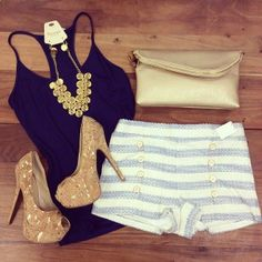 Summer outfit with navy tank top, heels, and high waisted shorts