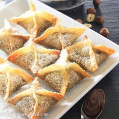 Nutella wontons are such an easy way to whip up a quick dessert. The chocolatey hazelnut spread inside the deep fried wonton pairs perfectly with a cup of coffee. You can make them in advance, but they will definitely taste better if eaten right away.     Ingredients: 1/4 cup