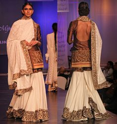Manish Malhotra. Ivory malmal sharara teamed with a brown raw silk jacket along with an ivory chikankari dupatta.