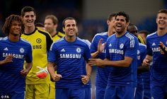 New faces: Chelsea fans welcomed summer recruits Cesc Fabregas and Diego Costa to Stamford Bridge