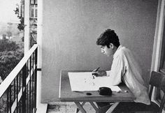 Orhan Pamuk, as a young man, at his drawing table in Istanbul.