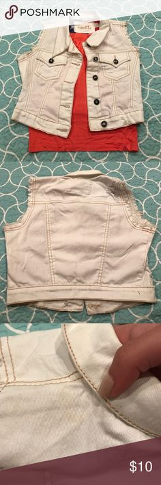 Denim crop vest Gently worn cream colored crop vest. There is some yellow discoloration on the vest, but it is very unnoticeable. I have included a picture to try to show it. I think it will come out with a wash in oxy clean! Perfect for country concerts! Also not urban just here for exposure! Urban Outfitters Tops Crop Tops