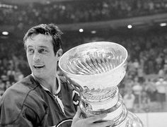 """NHL Hall of Famer Jean Beliveau (Joseph Jean Arthur """"Le Gros Bill"""" Béliveau), CC GOQ was a Canadian professional ice hockey player who played parts of 20 seasons with the National Hockey League's Montreal Canadiens. He was (December Ice Hockey Players, Nhl Players, Hockey Teams, Montreal Canadiens, Sports News, Wayne Gretzky, National Hockey League, Stanley Cup, Hockey Players"""