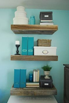 floating shelves + turquoise wall. this is so pretty! we could do this in the bathroom for added storage
