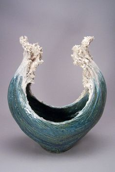 there is movement in this ceramic wave, there is a lot of texture shown and the wave appears that it is moving.                                                                                                                                                     More