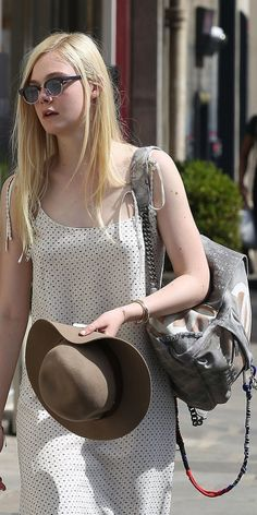 '90s throwback style inspiration: Elle Fanning wearing a Chanel backpack