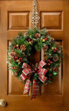 Evergreen wreath with berries & pinecones...
