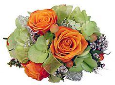 orange/peach roses, green hydrangea and wax flower