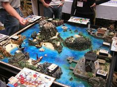 BGG Picture Museum Photo Album Playing Games on Super-Sized Boards Lego Station, Pirates Cove, Sea Pirates, Tabletop, Pirate Island, Warhammer Terrain, Board Game Design, Wargaming Terrain, D&d Dungeons And Dragons