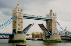 Tower Bridge is a combined bascule and suspension which crosses the River Thames. The iconic Tower Bridge was built in 1894 to relieve congestion on London Bridge. The bridge was designed to fit in well with the adjacent Tower of London from which it. London Bridge, Tower Of London, London Places, Suspension Bridge, Red Boots, River Thames, Culture Travel, Oh The Places You'll Go, Tower Bridge