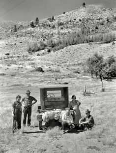 """July 1936. """"Vernon Evans [interview] and family of Lemmon, South Dakota, near Missoula, Montana. Leaving the grasshopper-ridden and drought-stricken area for a new start in Oregon or Washington. Expects to arrive at Yakima in time for hop picking. Makes about 200 miles a day in Model T Ford. Live in tent."""" Medium-format nitrate negative by Arthur Rothstein."""
