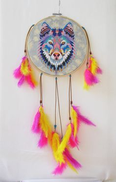 https://flic.kr/p/23T8NGS | NATIVE AMERICAN WOLF DREAMCATCHER |  Handmade embroidery on canvas (picture canvas, very high density, very difficult to embroider), with painted background in special textile paint, in metallic colors (silver and pearl ivory) with natural leather cord and porcelain beads Greek and Marabou feathers (yellow, pink and magenta). The embroidery frame is made of beech wood, painted colorless, the diameter is 20 centimeters.