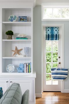 built-in bookcase with coastal accents | LLH Interiors