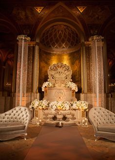 The Colin Cowie Celebrations team pulled out all the stops for this wedding at The Plaza Hotel in New York City. For one of the chicest ceremony setups ever, the dashing couple exchanged vows flanked by white blooms, crystal strands and metallic lounge furniture. The reception space dazzled, with cr