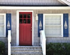 Decorative Sail Boat Shutters with a Red Front Door for a #Nautical and #Coastal look via Completely Coastal