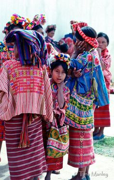GUATEMALA, GRANDADILLO:  Mam women and girls in traditional dress wait to be seen at a medical clinic in their remote village in the Northwestern Highlands of Guatemala.