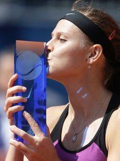 Czech Republic's Lucie Safarova kisses the trophy after winning the final match at the WTA tennis tournament in Prague, Czech Republic, Saturday, April 30, 2016. (AP Photo/Petr David Josek)