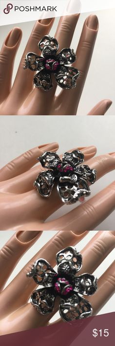 Brand-new big chunky adjustable ring pink floral Brand-new big chunky adjustable ring 💍 Fashion jewelry for women's & ladies. Pink floral flower 🌺 design. Check out my closet, we have a variety of Victoria Secret, Bath and Body Works, handbags, Aerosoles, shoes, fashion jewelry, women's clothing, Beauty products, home decors & more...  Ships via USPS. Don't forget to bundle, you save big! Always a FREE GIFT with every purchase!!! Thank you & Happy Poshing!!! Jewelry Rings