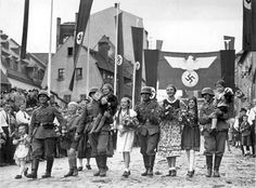 Germans out for a parade, notice how happy they are.