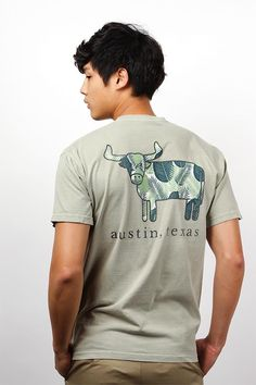 """Get Austin, Texas spirit and style with the Comfort Colors Collection - Austin, Texas - Tropical Leaves Steer T-Shirt! This unisex top features a distressed screen-printed steer on the front pocket filled with tropical leaf pattern above """"austin, texas"""" text. An enlarged version of the same design is on the back of the shirt. Made from 100% ringspun cotton."""
