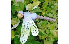 Dragonfly stake in my flower garden.
