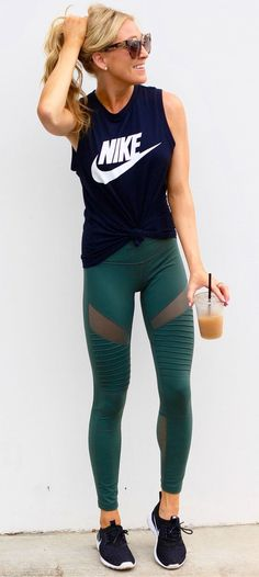 #fall #outfits women's black crew-neck Nike printed sleeveless shirt, green tights, and pair of black-and-white Nike Roshe Run sneakers outfit