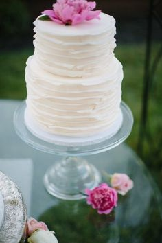 ruffled layer cake topped with a peony |  Photography by abiqphotography.com |   Read more - http://www.stylemepretty.com/2013/08/05/oakland-wedding-from-abi-q-photography/