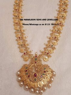 Beautiful 98 gram weight long haaram with lkshmi kasu pattern alternative lakshmi kasu pearl. Huge locket with pearls and kasu hangings. 18 May 2018 Gold Bangles Design, Gold Jewellery Design, Gold Jewelry, Jewelery, Gold Necklace, Mango Necklace, Fancy Jewellery, Jewellery Shops, Necklace Set