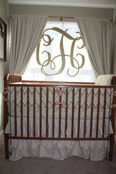Love the look - gold monogram in the window of the nursery!