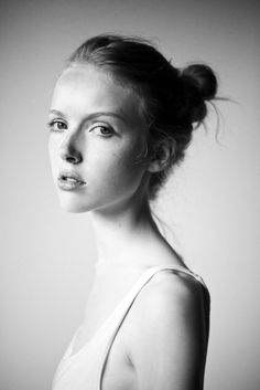 we love this simple, stripped-down look, reminding us that a fresh face and a simple bun are sometimes all one needs.