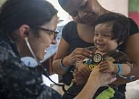 150417-N-KG407-253 HATTIEVILLE, Belize, (April 17, 2015) Lt. Cmdr. Melissa Buryl, from Canton, Ohio, a pediatrician stationed at Naval Medical Center Portsmouth, Va., checks a child's vital signs at the Hattieville Government School. The school is one of two medical mission sites set up for medical personnel from the Military Sealift Command hospital ship USNS Comfort (T-AH 20) to provide services during Continuing Promise 2015. Continuing Promise is a U.S. Southern Command-sponsored and…