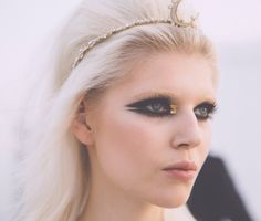 Dramatic eyeliner with gold accent at Chanel Cruise 2015