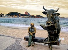 Poet Carlos Drummond de Andrade and Cow Parade! only in Copacabana