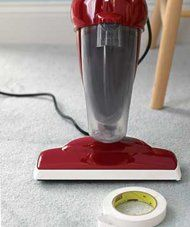 Masking tape on the vacuum to prevent scuffs...perfect for my freshly painted walls and baseboards!