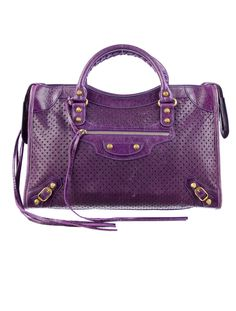 Perfectly perforated with this Balenciaga Purple City Bag.