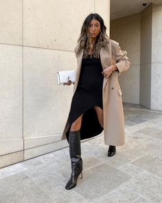 Black knit dress with slit, camel trench and Jimmy Choo knee high boots #streetstyle2020 #modernclassicstyle #fashiontrends2020 (Kayla Seah) Girls Party Dress, Girls Dresses, Black Knees, Slit Dress, Girls Night Out, Modern Classic, Southern California, Knee High Boots, Trench