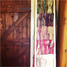 An old wooden ladder painted & used for Scarf storage.a great way to display all your scarves without putting them in boxes & forgetting about the ones at the bottom! by regina Ladder Storage, Scarf Storage, Gift Shop Displays, Photo Displays, Organize Your Life, Organizing Your Home, Old Wooden Ladders, Master Closet, Cool Fonts