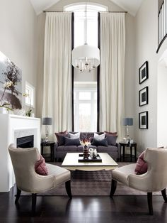 Contemporary Living Room, nice soft colors and beautiful use of double height.