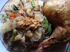 """Pansit """"vermicelli"""" with fried chicken typical pinoy food"""