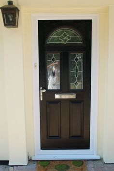 Black composite Front door with white frame and decorative glass. Solidor