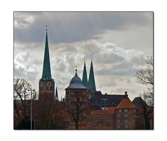 The Burg gate, St. Jacobi church and St. Mary church in Lübeck.