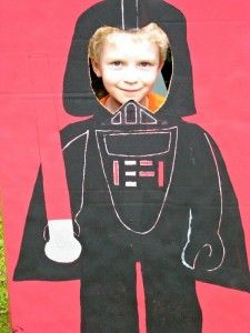 "Maybe we could do a ""Star Wars"" lap for the kids?  Help them make Darth Vador or Storm Trooper costumes, give them ""light sabers"" and play Star Wars music..."