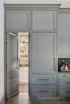 "Atlanta kitchen with a soaring ceiling To the left of the range, Jennifer's ""secret door"" opens to reveal a secondary prep zone and storage spot. – Photo: Lisa Mowry / Design: Clay Snider - Own Kitchen Pantry Kitchen Pantry Design, Kitchen Pantry Cabinets, Kitchen Doors, Prep Kitchen, Kitchen Ideas, Kitchen With Pantry, Kitchen Cabinet Door Styles, Boho Kitchen, Kitchen Units"